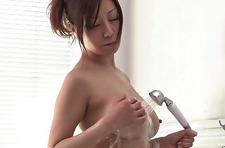 Challenging Chihiro Akino plays upon the brush chubby funbags with the addition of pussy